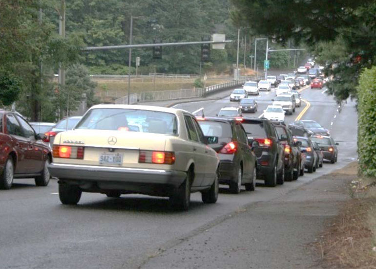 Cars stop and line up on 145th Street waiting to access the I-5 interchange.